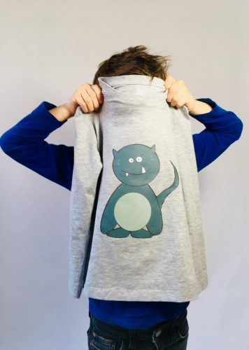Photography of child holding shirt with monster print: 'Woektiedoedel' (photo and graphic design by SBP)